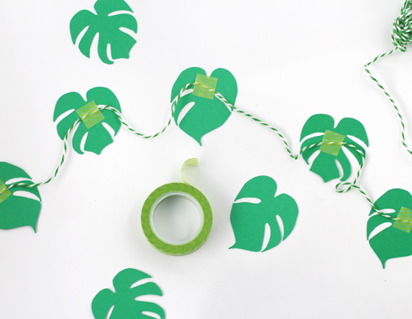 monstera plant garland and cupcake toppers